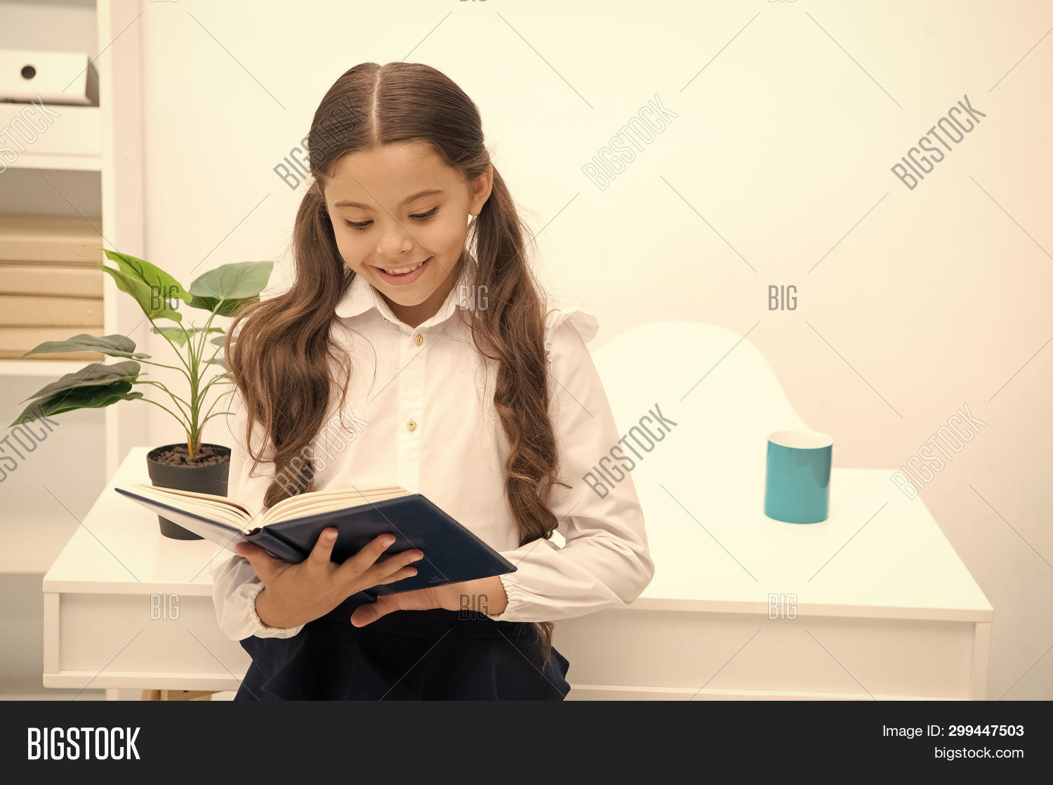 about,adorable,background,book,caucasian,cheerful,child,childhood,cute,diligent,education,excited,face,formal,girl,hairstyle,happy,interesting,interior,kid,knowledge,lesson,little,perfect,pupil,read,school,schoolgirl,sit,small,smart,smile,stand,study,subject,such,table,textbook,tidy,topic,uniform,while,white