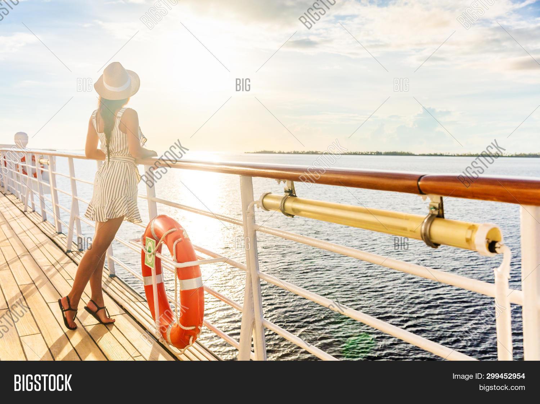 balcony,boat,buoy,carefree,caribbean,cruise,cruiseship,cruising,deck,dress,elegant,end,enjoy,europe,flare,french,girl,glow,happiness,happy,hat,hawaii,high,holiday,holidays,honeymoon,lifestyle,luxury,mediterranean,outdoor,people,person,polynesia,railing,sea,ship,silhouette,summer,sun,sunlight,sunset,sunshine,tahiti,tourist,travel,vacation,vacations,voyage,woman,young