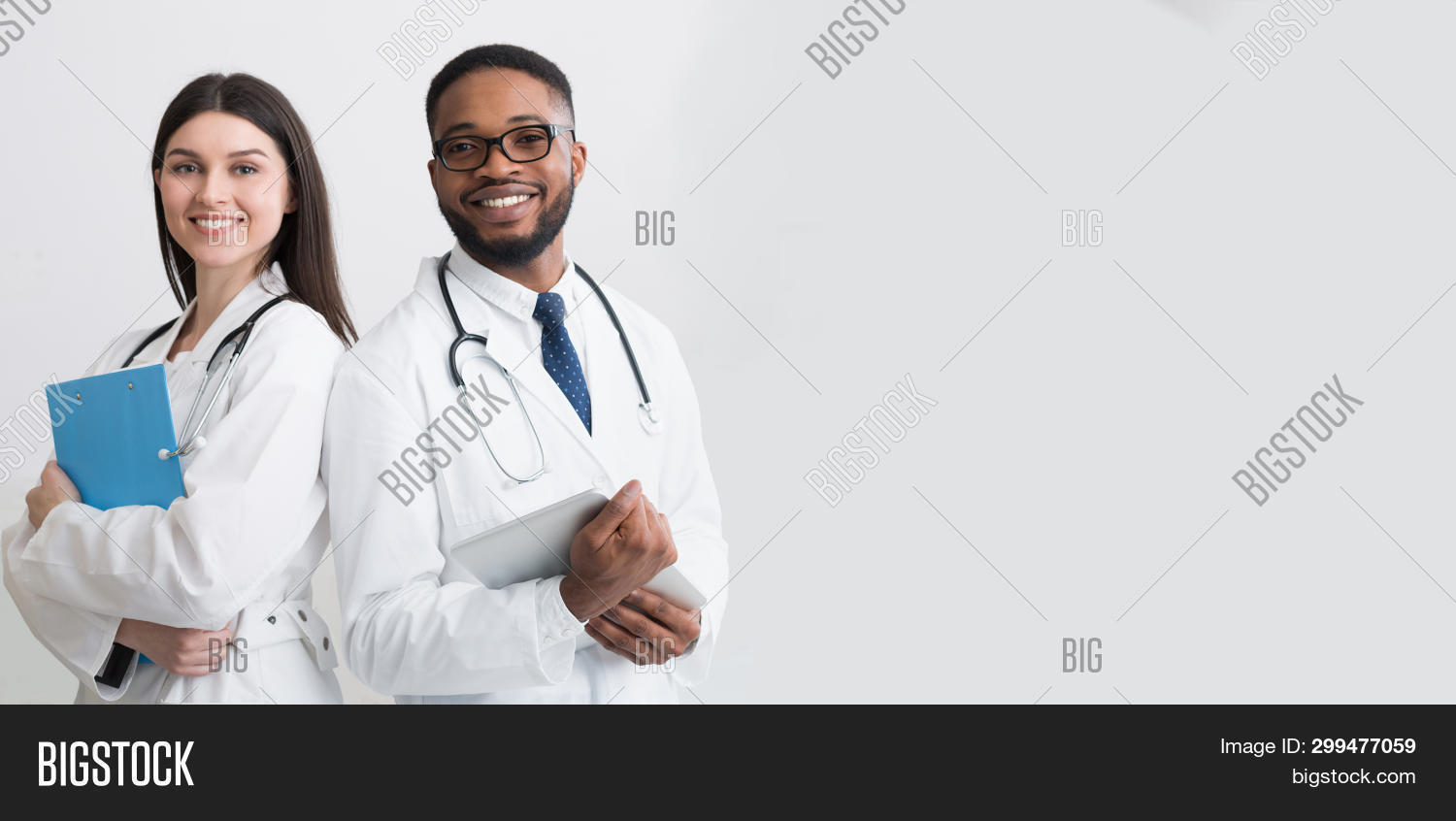 african,afro,background,black,clinic,coat,confident,dentist,diverse,doctors,excellent,gesturing,gray,hands,happy,health,healthcare,hospital,intelligent,job,male,man,medic,medicine,modern,panorama,pediatrician,people,perfect,practitioner,professional,showing,smiling,specialist,stethoscope,successful,surgeon,therapist,toothy,two,uniform,white,woman,work,young