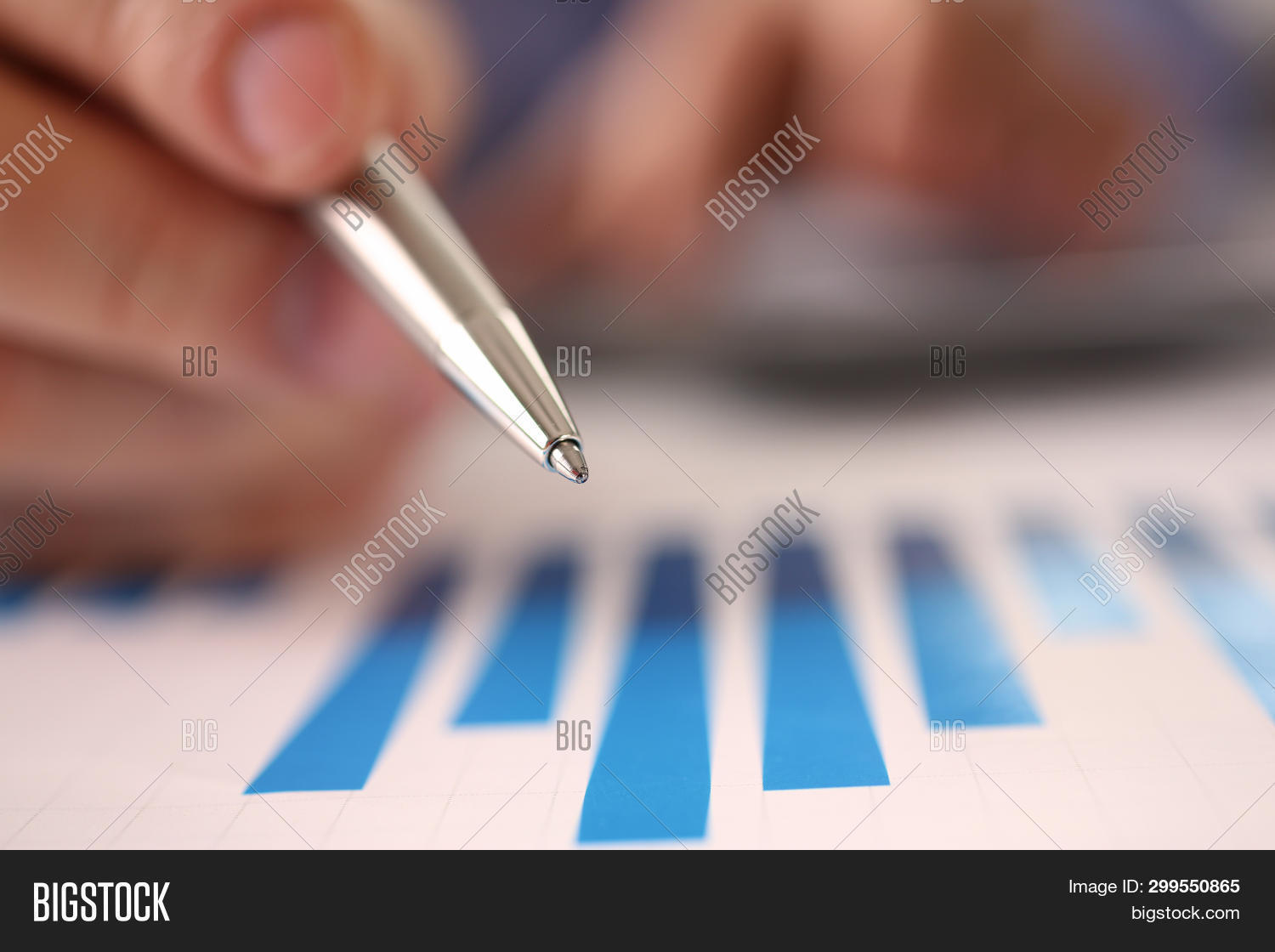 accountant,accounting,analysis,analyzes,audit,balance,budget,business,businessman,busy,calculate,caucasian,chart,check,closeup,company,cost,counting,credit,desk,economy,expense,expertise,finance,financial,graph,growth,hand,hold,income,loan,macro,man,manager,paper,payment,pen,performance,person,planning,profit,report,revenue,risk,stationery,tax,vat,workplace,workspace
