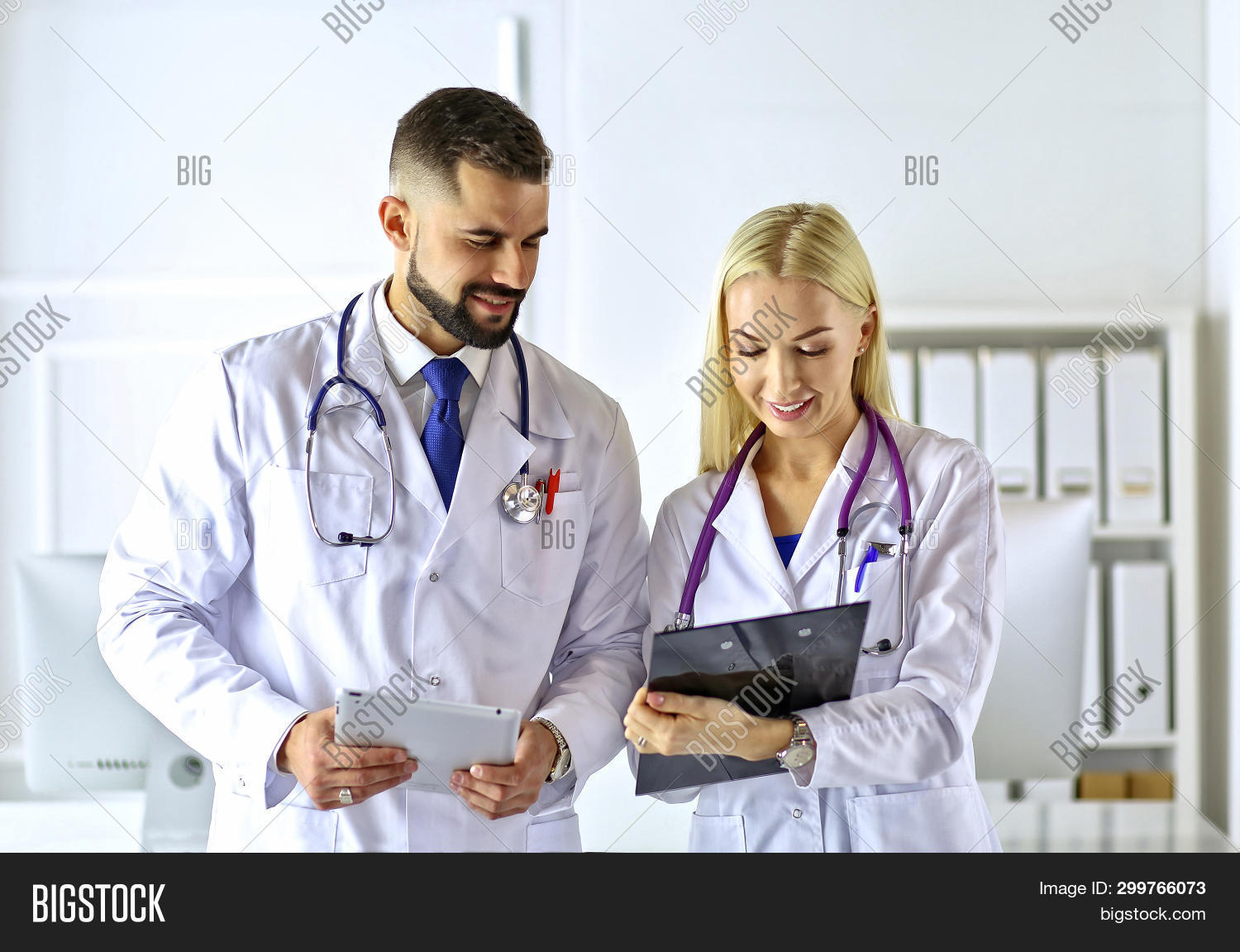 beautiful,cardiologist,clinic,clipboard,colleagues,computer,confident,consultant,discuss,discussion,doc,doctors,expert,female,friendly,group,hands,health,hold,intelligent,italian,latin-american,male,man,medic,medical,medicine,office,people,person,physician,point,positivity,practitioner,robe,smart,smiling,specialist,staff,stethoscope,talk,team,teamwork,trust,two,uniform,white,woman,worker,young