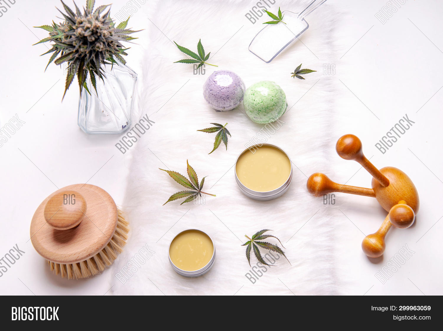 Assortment of cannabis topicals with bath bombs and marijuana salve isolated over white background -