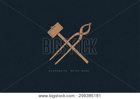 Hand drawn blacksmith tools on a dark background. Crossed hammer and tongs. Old logo, symbol in retro style. Monochrome style. Vector illustration. stock photo