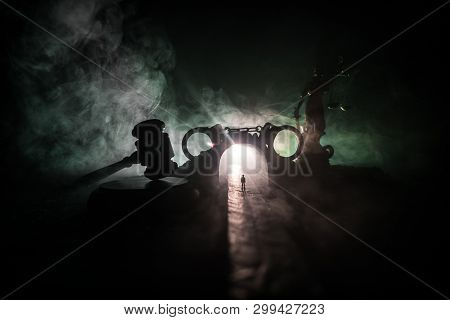 Abstract alcoholism concept. Silhouette of a man standing in the middle of the road on a misty night with giant glasses filled with alcoholic beverage. Creative artwork decoration stock photo