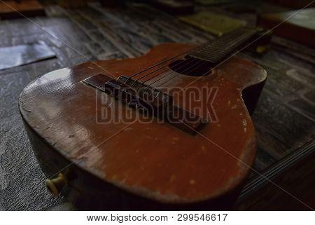 Old six-string guitar close-up. Original vintage music background stock photo