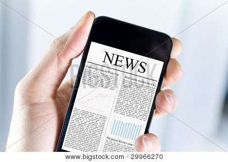 A man holding mobile smart phone with news article on screen. Closeup shot. stock photo