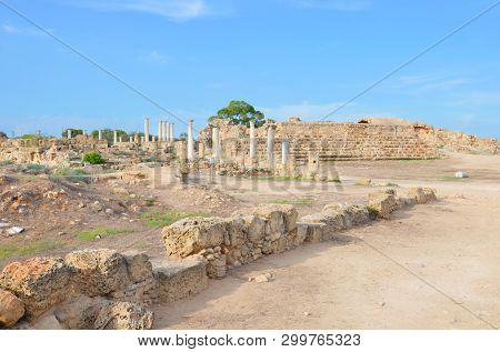 Amazing view of well preserved ruins of ancient city Salamis located near Famagusta, Turkish Northern Cyprus. The Corinthian columns were part of Salamis gymnasium. Popular tourist attraction stock photo