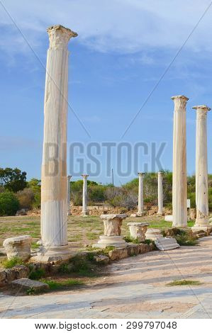 Beautiful ruins of Corinthian columns taken with blue sky above. The pillars are part of ancient Salamis complex located in todays Northern Cyprus. The ruins of the antique city are popular place stock photo