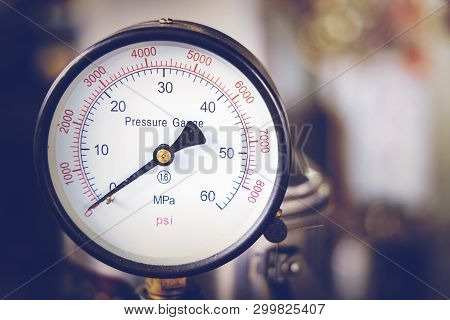 Close up of pressure gauge. Hydraulic Pressure Gauge. Gas pressure regulator with needle gauge, Measuring instrument close up on pneumatic control system. stock photo