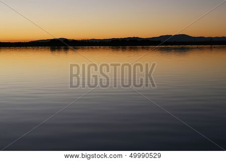 Balsa at sunset with the profile of the mountains in the background stock photo