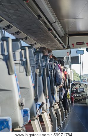 View from inside the bus with passengers. stock photo