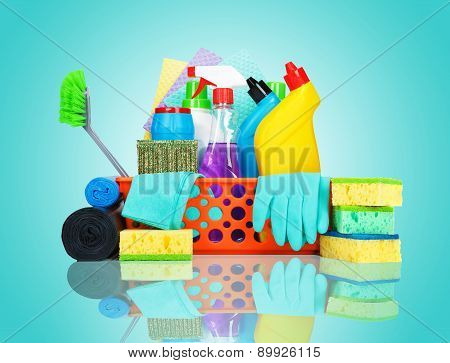 Cleaning supplies in a basket - cleaning and housekeeping concept stock photo