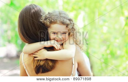 Mother\'s Day, Family, Childhood And People Concept - Happy Daughter Hugging Mother In Warm Sunny Sum
